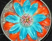 BIG,BRIGHT,BEAUTIFUL-2.5 INCH FLOWER MAGNET-TURQUOISE,ORANGE,WITH FABRIC AND JEWEL BUTTON CENTER