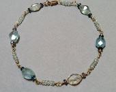 Tanzanite, Aquamarine, Iolite, Apetite and 18k gold bracelet.