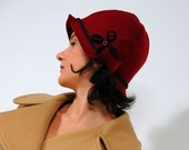 CURLY CLOCHE in BURGUNDY with blue ribbon