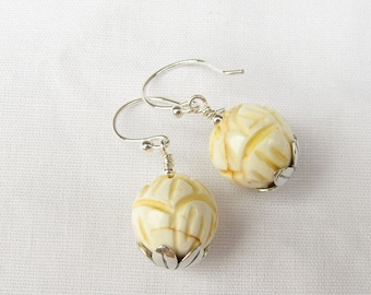 Carved shell lotus and Sterling silver earrings