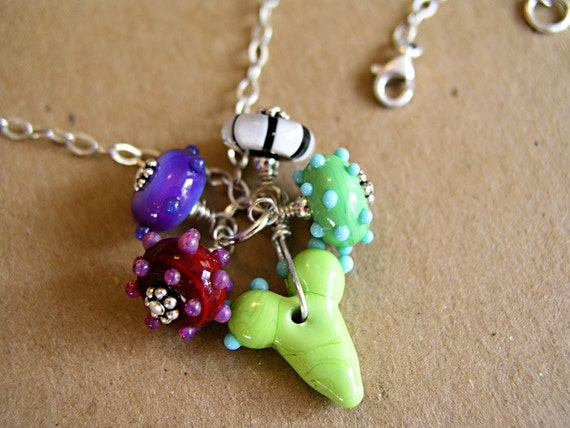Cluster Necklace featuring a lampwork beads and a green heart hiding out amoung the glass beads