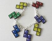 let's turn nintento off - tetris charm bracelet