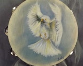 The Dove / 10 inch Tambourine with a oil painting of a Dove. 5.00 Dollars OFF