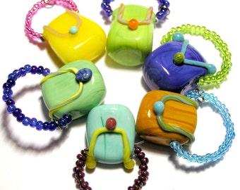 Handmade lampwork cute little BAGS - one bead