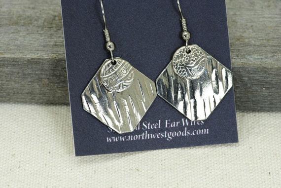 Lots of silver earrings