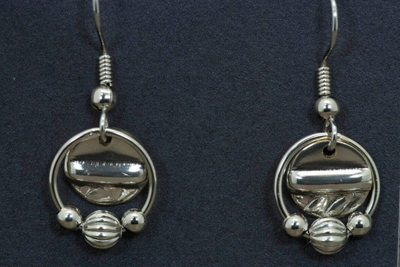 Silver dangly earrings with silver beads