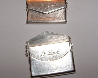 10 small matte silver plated over brass charm pendant envelopes with an I love you note inside