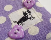 Polka dot change purse in purple with dog motif