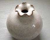 small white bud vase