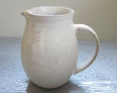 small white creamer - 3 inches tall
