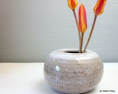 small white ikebana vase with flower frog (kenzan) 2 1/2 inches tall