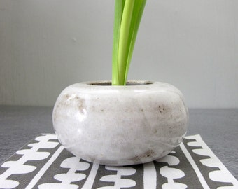miniature white ikebana vase with kenzan (flower frog)