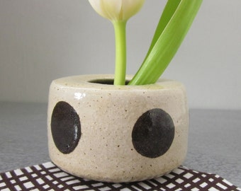 polka dotted pottery vase with flower frog