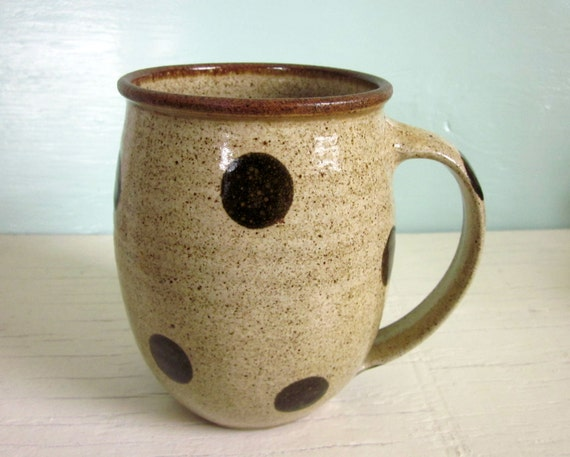 pottery coffee mug with dark polka dots
