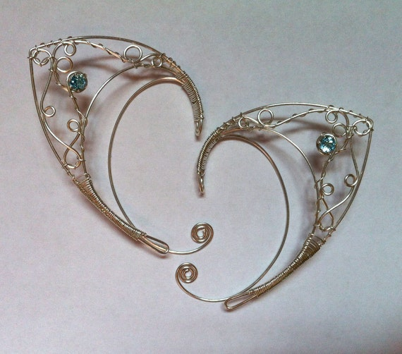 Silver elf ears with faceted blue topaz