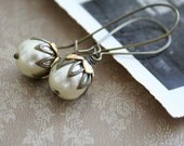 Gilead. Antiqued filigree flowers and cream pearl earrings.