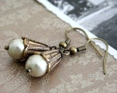 Ashley unearthed pearl earrings. Antiqued golden brass metalwork, with glowing beige pearls. Romantic, rustic, and perfect for any outfit.
