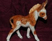 Earthenware ceramic custom glazed pinto donkey foal