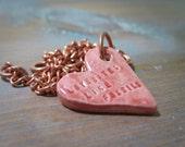 lovebites like fossils -- porcelain poem pendant