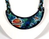 """Ringed Planets Ceramic Necklace with Braided cord in Black, Blue and Green 19"""""""