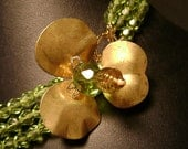 Necklace with Brass Dogwood Flower and Green Beads