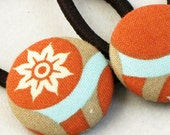 Rust and aqua ponytail covered button pair with Joel Dewberry designer fabric