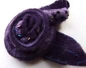 purple brooch