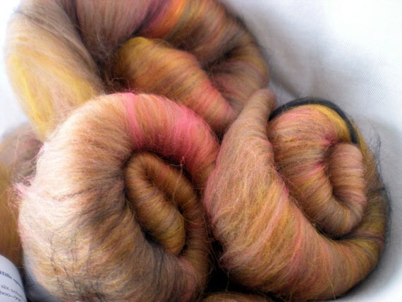 Spinning batts, 1.2 oz with  the warm colors of autumn in a Merino wool and bamboo blend. Experience the softness of November Hills fiber.