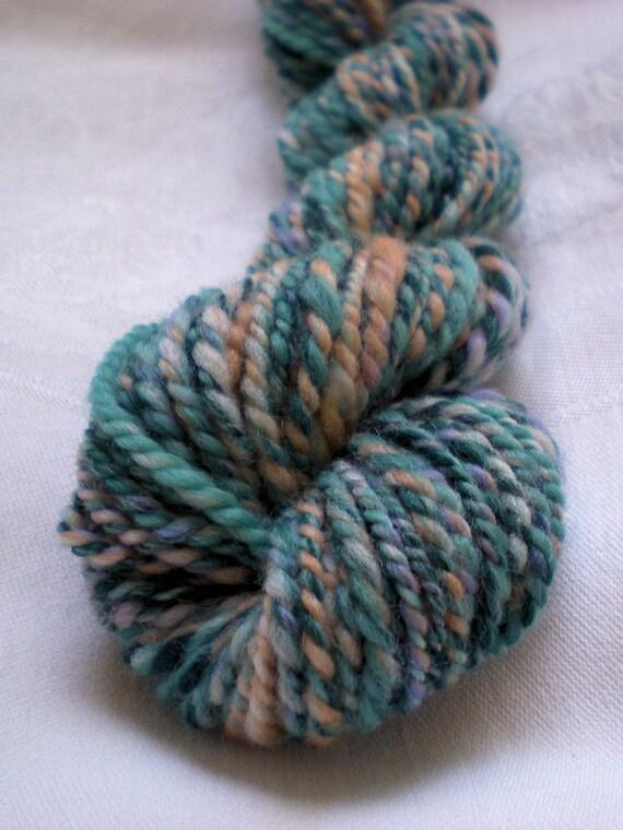 Handspun yarn from Merino wool, Sandia. Worsted weight, 0.8 oz (24 g), 46 yds (42 m)