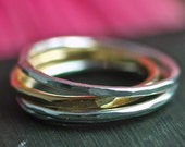 SPECIAL on sale Tiny Stack set of four hammered ring bands 3 sterling silver and 1 14 karat gold vermeil