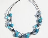 4 Strand Necklace in blues and lilac