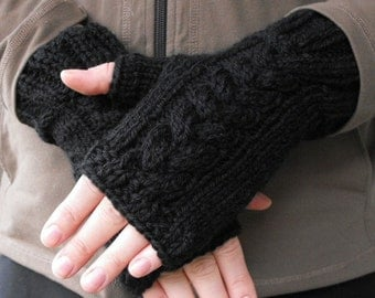 Black handknit fingerless cabled mittens