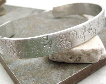 Pollination Bracelet, flowers, birds, butterflies, and bees, custom aluminum cuff approx 3/8 inch wide