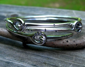 Three sterling silver bangle bracelets
