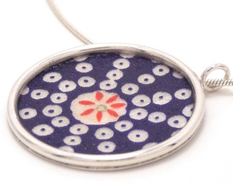 white dots on blue pattern in sterling silver pendant on snake chain
