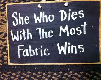 She who dies with the most fabric wins sign wood