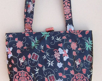 Reversible Tote Purse - black and red iridescent with plant motif