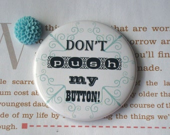 Don't push my button pocket mirror
