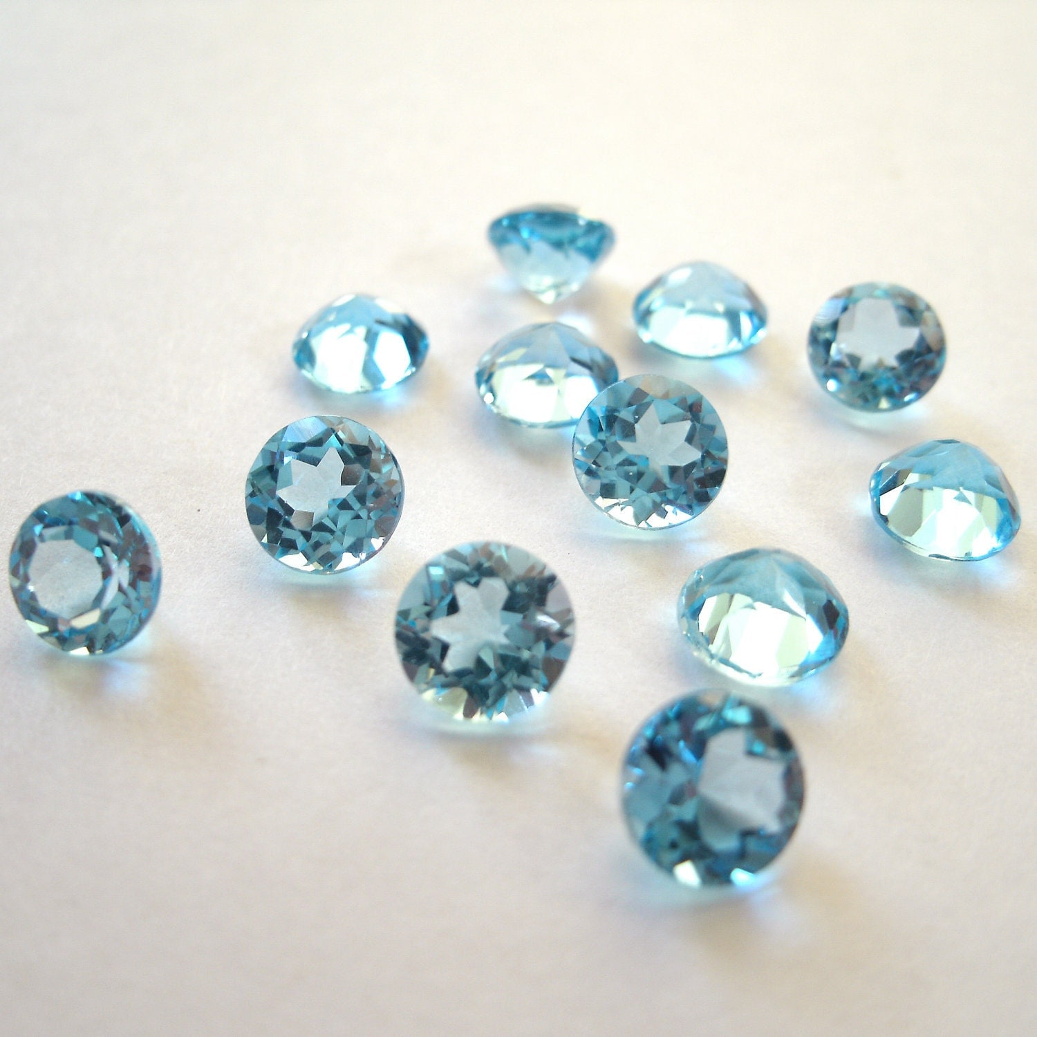 sale faceted gemstones swiss blue topaz brilliant cut 5mm for