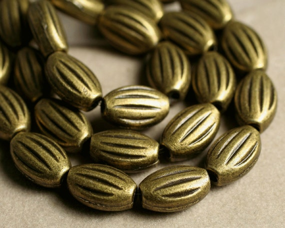 SALE Antique brass oval beads 10x6mm, 14-inch strand (item ID YWAB3D2616)