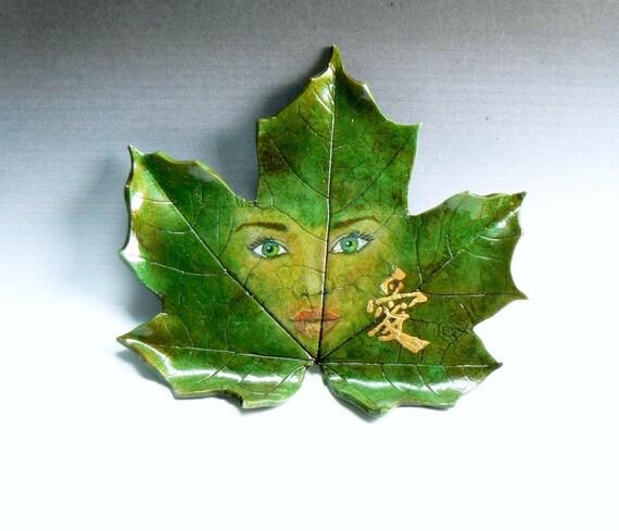 hand sculpted maple leaf natures spirit ornament