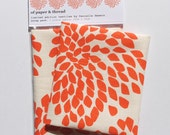 Scrap of Protea fabric (orange on cream)