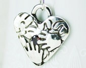 Heart and Hands Fine Silver Pendant with Amethyst Cubic Zirconia