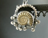 Ancient memory............  pyrite ammonite and sterling silver.