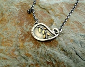 Small, Sterling Silver ,Paisley Necklace with Brass Accents.