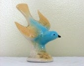 vintage blue and yellow bird statue