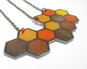 geometric shrink plastic honeycomb necklace  in golden hues