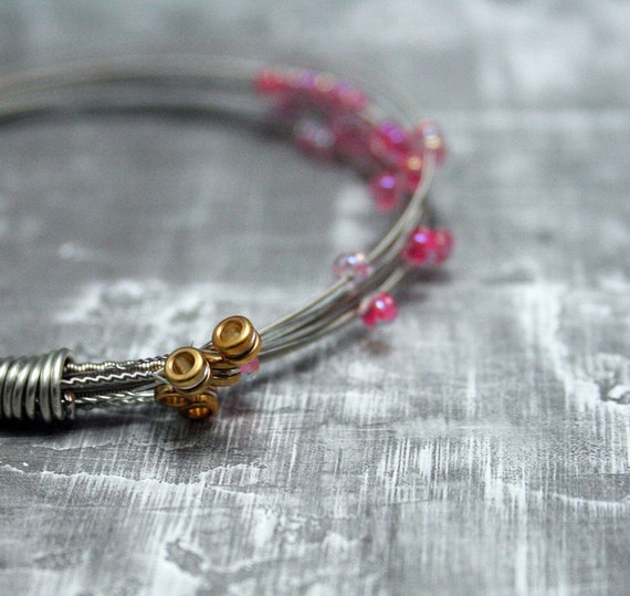 items similar to guitar string bracelet beaded pink made to order on etsy. Black Bedroom Furniture Sets. Home Design Ideas