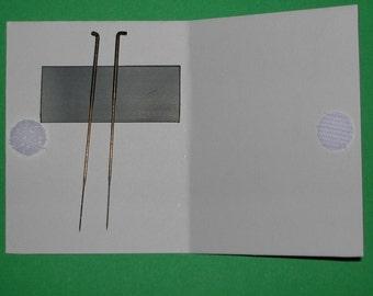 Felting needle holder with 2 needles.