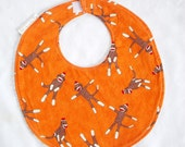 Sock Monkeys on Orange - Boutique Bib - terry cloth backing with snag free velcro closure
